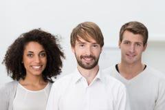 Equipo multiétnico joven acertado del negocio Imágenes de archivo libres de regalías