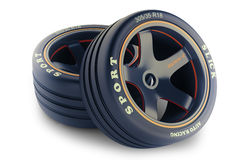 Equipo pulido de las ruedas para el coche de carreras Imagenes de archivo