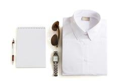 Equipos casuales con los accesorios en el fondo blanco Fotos de archivo libres de regalías