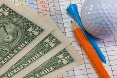 Equipos de golf y billetes de banco del dólar de EE. UU. Imagen de archivo