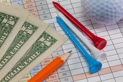 Equipos de golf y billetes de banco del dólar de EE. UU. Fotografía de archivo libre de regalías
