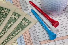 Equipos de golf y billetes de banco del dólar de EE. UU. Imagenes de archivo