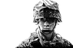 Equipped army soldier with dirty face studio shot stock photos