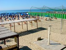 Equipped beach. Italian beach equipped with chairs, umbrellas, showers, beach volley field, cabins, etc royalty free stock image