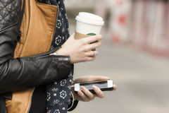 Equipped with coffee and mobile phone Stock Photos