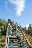 Equipped and fenced walking path, leading to mountain top, and blue sky. Perspective view. stock photos