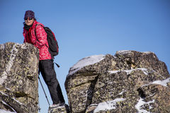 Equipped hiker woman hiking in a high mountain on the rocks Stock Photography