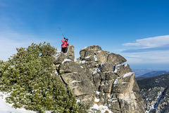 Equipped hiker woman hiking in a high mountain on the rocks Royalty Free Stock Image