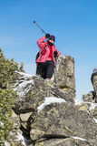 Equipped hiker woman hiking in a high mountain on the rocks Royalty Free Stock Photography