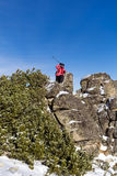 Equipped hiker woman hiking in a high mountain on the rocks Royalty Free Stock Photo
