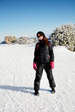 Equipped tourists woman with pink gloves   on a ski slope in Bulgaria,Borovets Royalty Free Stock Image