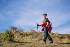 Equipped woman hiking in a high mountain Royalty Free Stock Photo