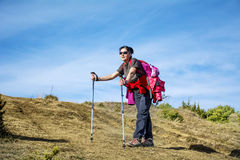 Equipped woman hiking in a high mountain Royalty Free Stock Photography