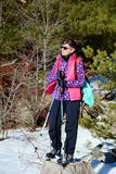 Equipped woman hiking in a high winter  mountain Stock Images