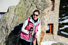 Equipped woman hiking in a high winter mountain Royalty Free Stock Photography