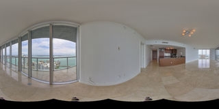 Equirectangular panoramic living room photo. Equirectangular panoramic image of a balcony with city view stitched for virtual tour software Stock Photo