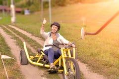 Equitação da atração em triciclos imagens de stock royalty free