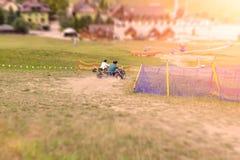 Equitação da atração em triciclos fotos de stock