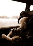 Equitação do menino no carseat Imagens de Stock Royalty Free