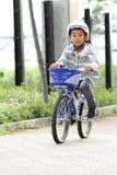 Equitação japonesa do menino na bicicleta Fotos de Stock Royalty Free
