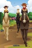 Equitación de la gente joven en un rancho stock de ilustración