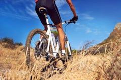 Equitação da bicicleta de fuga Imagens de Stock