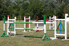 Equitation obstacles and barriers on a show jumping event Stock Photos