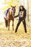 Equites con il suo cavallo Fotografia Stock