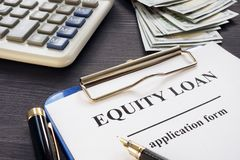 Equity loan form on a table. stock images