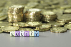 Equity text and gold coins Stock Photos