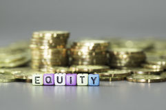Equity text and gold coins Royalty Free Stock Images
