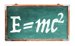Equivalência de energia maciça da equação da teoria de relatividade E=mc2 de Einsteinno quadro de madeira largo do vintage sujo imagens de stock royalty free