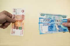 Equivalent exchange of one five thousand Russian banknotes for smaller money in two and one thousand rubles. New money. Equivalent exchange of five thousand Royalty Free Stock Photography