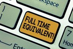 Equivalente a tempo completo do texto da escrita da palavra Conceito do negócio para a unidade que indica a carga de trabalho do  imagens de stock