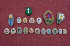 1er anniversaire avec les pierres colorées Photographie stock libre de droits