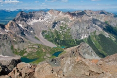 14er View from the Top of Mount Sneffels 14,150 Feet above sea level. One of the highest mountain peaks in the lower 48 contiguous US. Blue lakes below show off royalty free stock photography