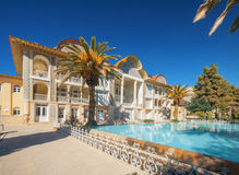 Eram gaden, the voew on building with water pool, and palm trees. Royalty Free Stock Images