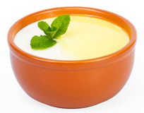 Сeramic cup milk soup with butter Stock Photos