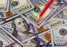 Erarer deleting one hundred dollar bills. Close-up of new one hundred American dollar bills. Looks like a pencil eraser is trying to erase the number 100 from Royalty Free Stock Photography