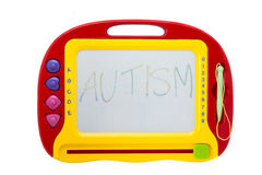 Erasable drawing board with the word Autism Stock Photos