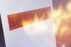 Erase Internet History. An Erase Internet History sign on a computer screen and flames from a  fire Stock Images