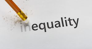 Erase part In in word Inequality on white background. Equality concept. Erase part In in word Inequality with pencil eraser on white background, panorama stock photos