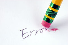 Erase the word Error with a rubber. Concept of eliminating the error/mistake royalty free stock images