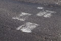 Erased road markings. Erased lines and road markings, painted on asphalt. close-up royalty free stock photography