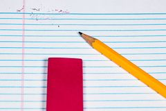 An erased word on a sheet of filler paper with the pencil and er. A 2 Pencil, Eraser, paper clips and Filler paper with plenty of room for Copy. An erased word royalty free stock images