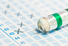 Eraser on blue answer sheet Stock Photography