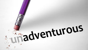 Eraser changing the word Unadventurous for Adventurous Stock Image