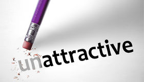 Eraser changing the word Unattractive for Attractive Royalty Free Stock Image
