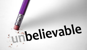 Eraser changing the word Unbelievable for Believable Royalty Free Stock Image