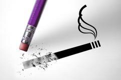 Eraser deleting a cigarette. An Eraser deleting a cigarette Royalty Free Stock Photos